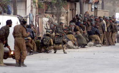 INDIAN PARAMILITARY TROOPERS DUCK AS SEPARATIST MILITANTS FIRE IN SRINAGAR.