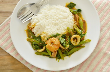 spicy stir fried shrimp and squid curry eat couple with rice