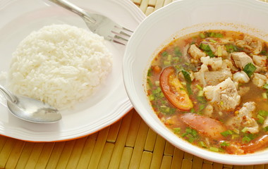 hot and spicy pork rib tamarind and Thai herbs soup eat couple with rice