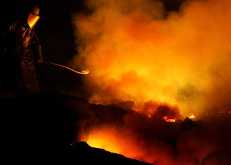 Worker at Arcelor steel plant works at furnace in Florange-Hayange