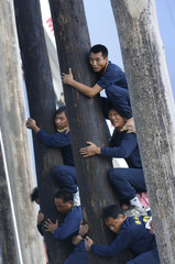 "Competitors climb the ""Ku Peng"" during the Chiang Ku contest as part of the Chinese Hungry Ghost Festival in Toucheng"