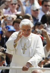 Pope Benedict XVI greets the crowd during his weekly general audience at the Vatican