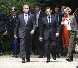 U.S. President Bush and French President Sarkozy walk to the U.S. Embassy Residence at the Elysee Palace in Paris