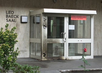 THE SYNAGOGUE'S SIDE ENTRANCE WAS DAMAGED BY A FIREBOMB IN DUESSELDORF.