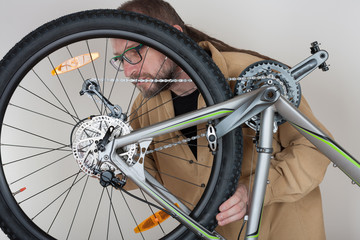 Bearded caucasian man repairing  the mtb bicycle