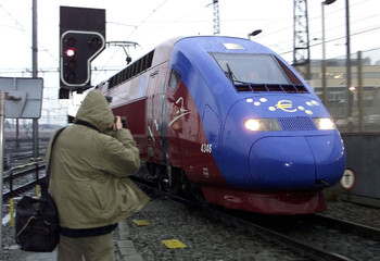 A HIGH-SPEED TRAIN EMBLAZONED WITH THE SYMBOL OF THE EURO ARRIVESAT BRUSSELS' SOUTH STATION.