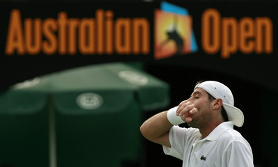 Grosjean reacts during his match against Rochus at the Australian Open tennis tournament in Melbourne