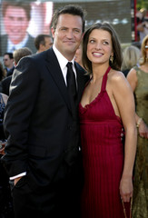 ACTOR MATTHEW PERRY AND GIRLFRIEND ARRIVE AT EMMY AWARDS.