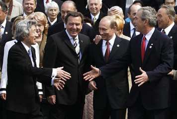 Leaders of World War Two powers greet each other after ceremonies in Red Square.