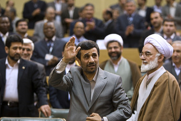 Iran's President Ahmadinejad arrives at the International Conference of the Prosecutors of Islamic Countries in Tehran