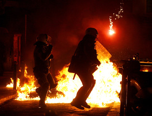 Riot police clash with demonstrators during riots near the Athens Polytechnic