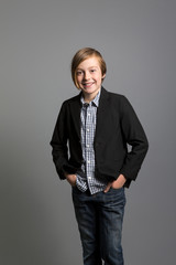 studio portrait of an upbeat boy