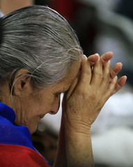 Supporter of former Costa Rican President Calderon prays before his sentencing in San Jose