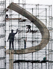 "Construction workers erect scaffolding around the monument known as ""JK"" which honors former Preside.."