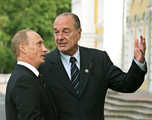 Russian President Putin chats with his French counterpart Chirac in front of the Peterhof Palace outside St Petersburg