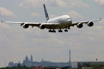 Airplane takes part in flying display two days before opening of 48th Paris Air Show at Le Bourget airport near Paris