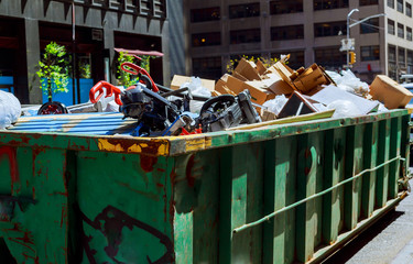 NEW YORK CITY - May 04, 2017 New York City Manhattan Over flowing Dumpsters being full with garbage