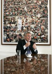 Austrian Chancellor Gusenbauer gestures during an interview with Reuters