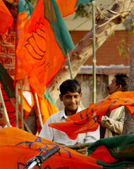 WORKERS OF INDIA'S HINDU NATIONALIST BHARATIYA JANATA PARTY CARRY PARTY FLAGS IN FAIZABAD.