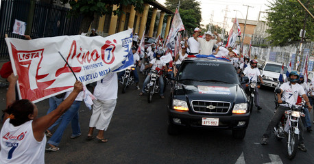 Paraguayan presidential candidate for the UNACE party Oviedo greets supporters as he rides through the streets of Asuncion