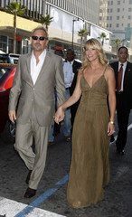 """Actor Kevin Costner and wife pose at the premiere of the film """"Swing Vote"""" in Hollywood"""