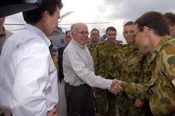 Australia's Prime Minister John Howard shakes the hands of Australian soldiers in Banda Aceh.