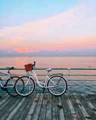 vintage bicycle on beach over blue sea and clear blue sky background, spring or summer holiday vacation concept.