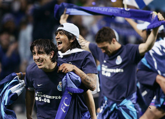 Porto's Fucile and Lucho celebrate winning the Portuguese Premier League title after beating Estrela Amadora in their soccer match at Dragon stadium in Porto