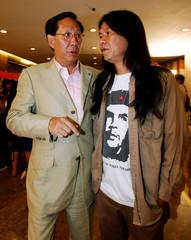 Popular broadcaster Albert Cheng and pro-democracy activist Leung Kwok-hung chat in Hong Kong.