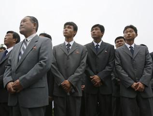 Members of the Pyongyang Railway Workers Union visit Solbatsan Cemetery in Yangsan