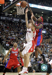 Toronto Raptors guard Ukic is fouled while trying to put up a shot against Los Angeles Clippers guard Taylor during their NBA basketball game in Toronto