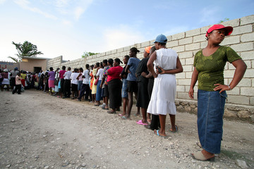 Haitians wait in line before the opening of Santo Espiritu clinic in Lilabois