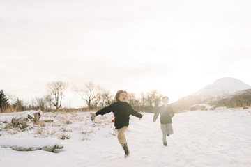 Two children playing in snow