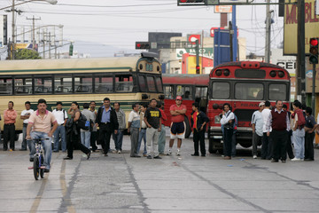 Bus drivers and their assistants block a road during a protest in Guatemala City
