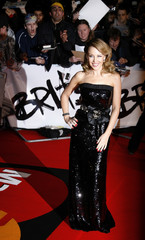 Australian singer Kylie Minogue poses for photographers as she arrives for the Brit Awards at Earls Court in London