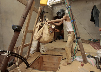 Palestinian smuggler hauls calf out from tunnel that goes beneath Egyptian-Gaza border