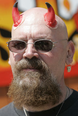 Paul Groenendal wears devil horns during 06/06/2006 activities in Hell, Michigan June 6, 2006. The t..