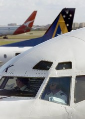 ANSETT PILOTS IN THE COCKPIT PREPARE TO DEPART THE SYDNEYAIRPORT.