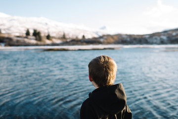 Boy looking out at lake