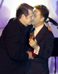 Sir Paul McCartney (R) embraces Beach Boys founder Brian Wilson as McCartney inducted Wilson into th..