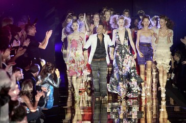 British designer Julien Macdonald celebrates his collection at London Fashion Week.