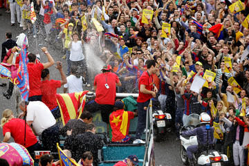 FC Barcelona's players celebrate and spray champagne in a bus after winning the Spanish League in ...