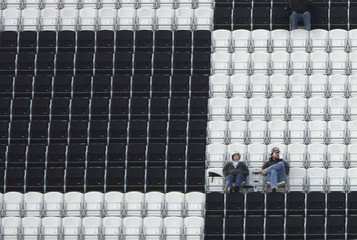 Two fans are in their seats for the Rolex 24 hour race in Florida
