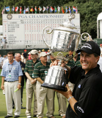 Phil Mickelson celebrates his birdie put on 18th green winning the PGA Championship in Springfield, New ...