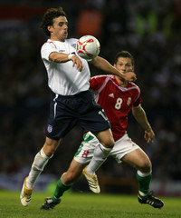 England's Hargreaves challenges Dardai of Hungary for the ball during their international friendly soccer match in Manchester