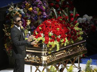 Usher performs next to the casket during memorial services for pop star Michael Jackson in Los Angeles