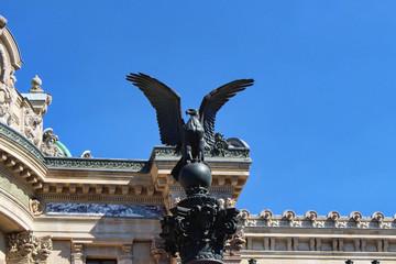 View on black eagle bird statue, blue sky, paris city, france