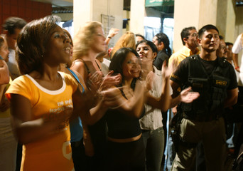 "Inmates clap during 2008 ""Melodies of Freedom"" singing contest at Santa Monica female prison in Lima"