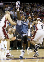 Charlotte Bobcats forward Gerald Wallace loses his balance against the Cleveland Cavaliers during their NBA basketball game in Charlotte