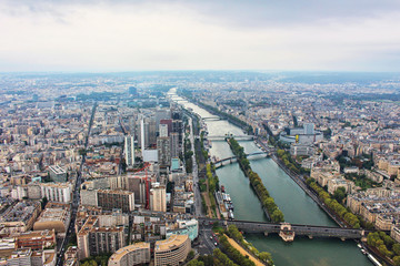 Panoramic view on paris city and seine river from the top of eiffel tower, france
